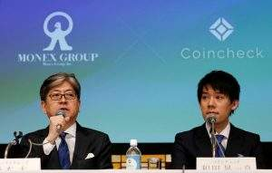 Monex Group Inc CEO Oki Matsumoto (L) and Coincheck CEO Koichiro Wada attend a joint news conference in Tokyo, Japan April 6, 2018.  REUTERS/Toru Hanai