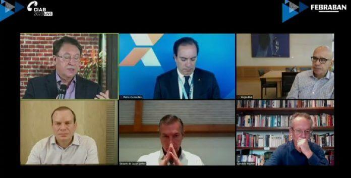 Painel de abertura do CIAB Live. Da esq. para a direita, João Borges, Pedro Guimarães, Sérgio Rial, Roberto Sallouti, Lazzari e Bracher. (Foto: Reprodução/Noomis